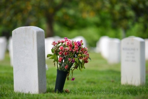 Flowers next to headstone